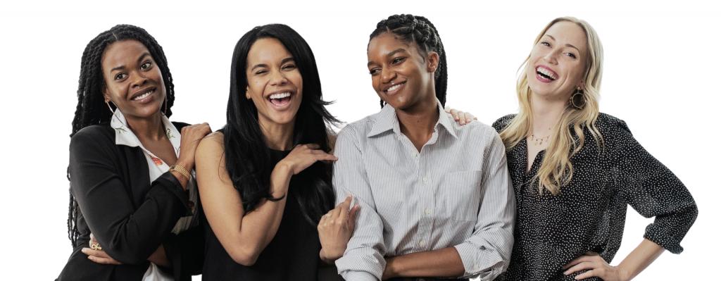 Happy confident businesswomen standing together
